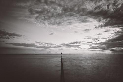 longexposure sky blackandwhite bw lake water clouds blackwhite dusk birdhouse mandeville causeway breakwall sunsetpoint lakepontchartrain ef1740mmf40l 5dmarkiii tyalexanderphotography northshorecanon