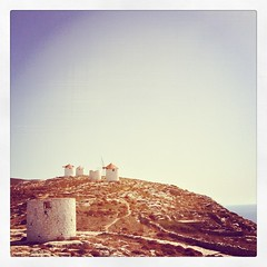If you walk up the hill behind our house for 50m, you come to a series of old windmills and a view all the way to the Dodecanese. #amonthingreece