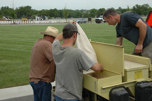 NRCS Soil Conservationist Allen Casey, Biological Technician Nick Adams and Plant Materials Center Manager Ron Cordsiemon select a blend of warm season grass seed for both drill and broadcast into the field at Jefferson Barracks National Cemetery. NRCS photo.