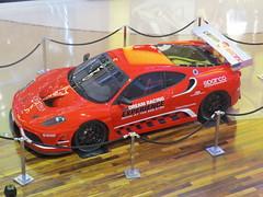 race track(0.0), race car(1.0), model car(1.0), automobile(1.0), racing(1.0), vehicle(1.0), stock car racing(1.0), performance car(1.0), automotive design(1.0), ferrari f430 challenge(1.0), ferrari f430(1.0), land vehicle(1.0), luxury vehicle(1.0), supercar(1.0), sports car(1.0),