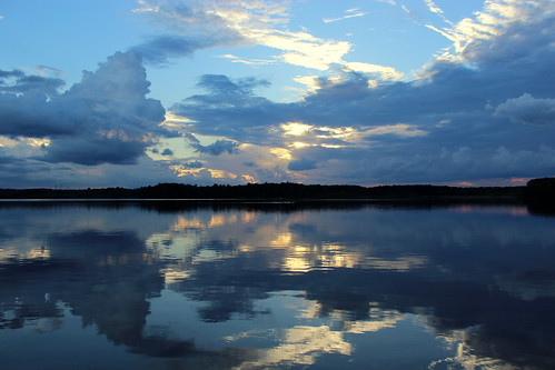 sunset reflections cloudy northcarolina lakecrabtree thunderstorms faithhill timmcgray