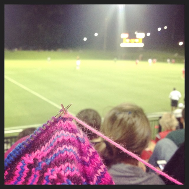 The sock is enjoying a warm evening at a college soccer game. #gobucs