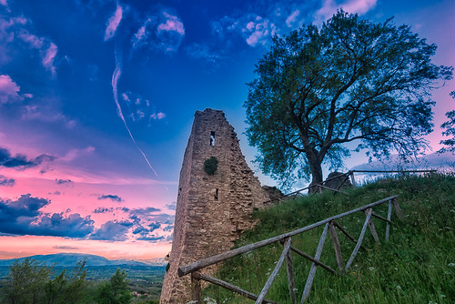 pink sunset building tree green tower castle abandoned grass landscape twilight ancient ruins view dominate outdoor hill violet historical setting umbria ruined giano morchicchia