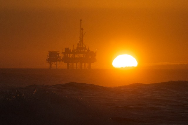 Sunset over the oil rig at Huntington Beach