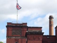 Masson Mills Shopping Village - British flag above Masson sign