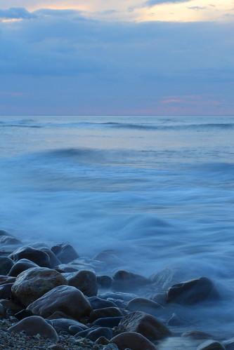 ny beach island stones tide shore hourlong montaukpointblue exposurerockswavestripodoceanhdrcolorcloudssunsetblurrydiffusedlightlong