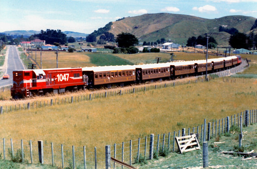 "<p>DB 1047 departing Mangatainoka, New Zealand with Steam Inc Excursion on 22/01/1984. <br /> <br /> DB 1047 was built in 1965 at General Motors EMD, Canada - EMD G8 (A2077) as DB 1004, entered service 05/1965  (livery:NZGR Carnation/Midland Red, with White strips), renumbered c1978 to DB 1047 and Written Off 04/1988. <br /> <br /> <br /> 17 Class DB (GM EMD G8 A1A-A1A 950hp (710kW)) were built at GM EMD London, Canada in 1965.<br /> Later 10 DB Locomotives were rebuilt to Class DBR (GM EMD G18) at Clyde, Rosewater, Adelaide, South Australia between 1980-1981. The Class was withdrawn in the late 1980's.<br /> <br /> <br /> For more information on Class DB (Gallery & Stock Lists), goto:-<br /> <a href=""http://nzrailwaysrollingstocklists.weebly.com/db---gm-g-8-of-1965.html"" rel=""nofollow"">nzrailwaysrollingstocklists.weebly.com/db---gm-g-8-of-196...</a><br /> & @ Wikipedia:-<br /> <a href=""https://en.wikipedia.org/wiki/New_Zealand_DB_class_locomotive"" rel=""nofollow"">en.wikipedia.org/wiki/New_Zealand_DB_class_locomotive</a><br /> .</p>"