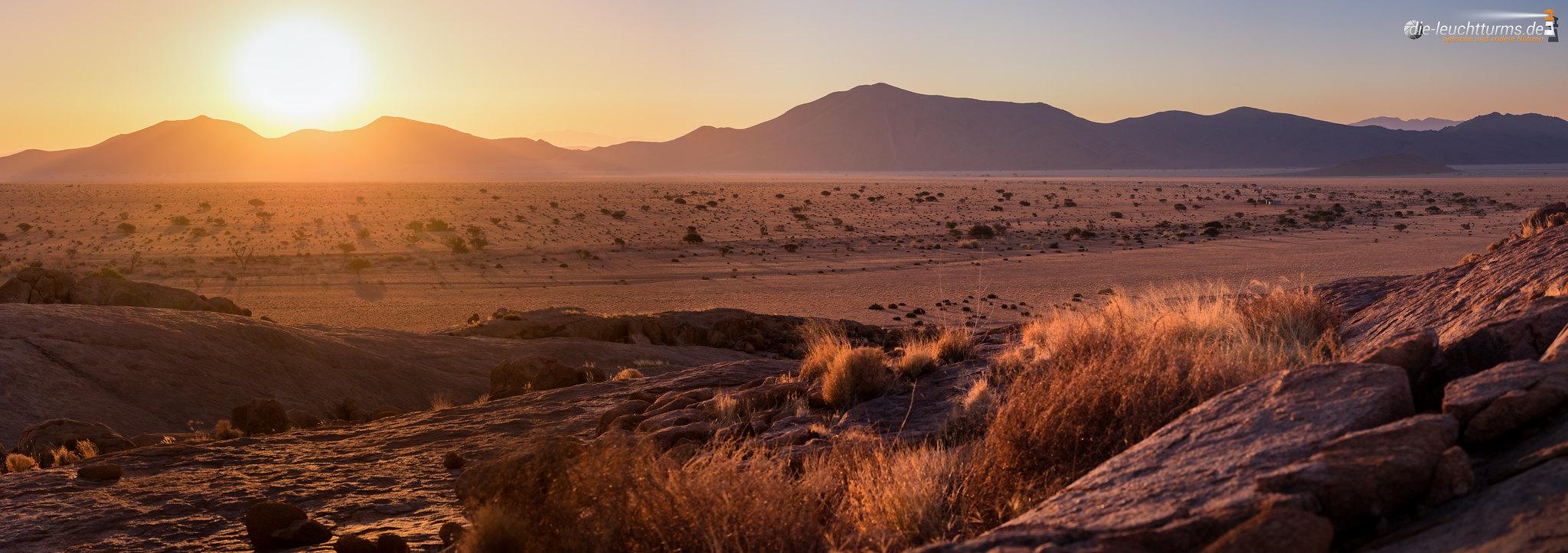 Setting sun behind the Tiras Mountains Vol