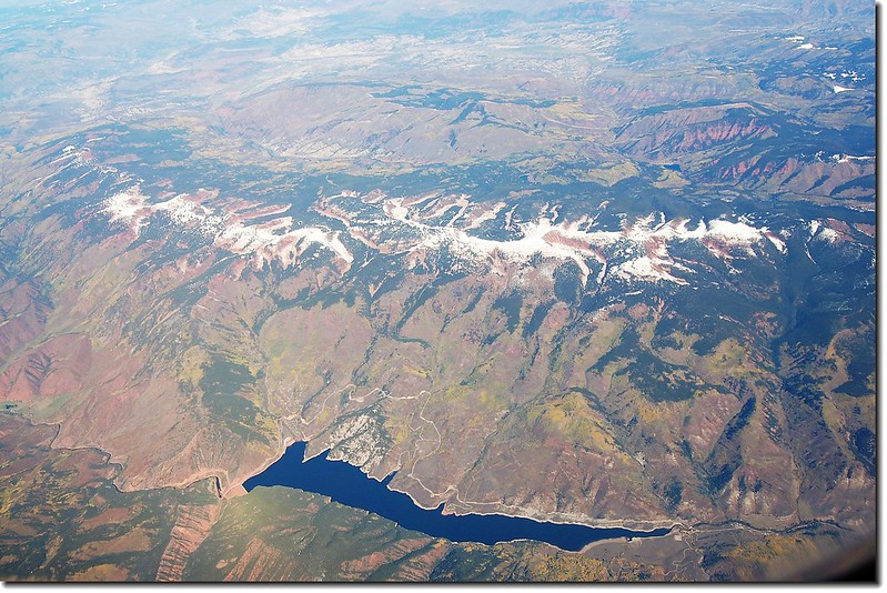 Looking down Ruedi Reservoir from the air,the mountain that snow covered is Red Table Mt. 1