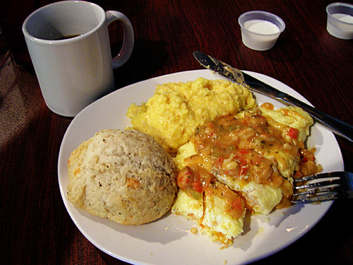 creole omelet, cheesy grits, and biscuit