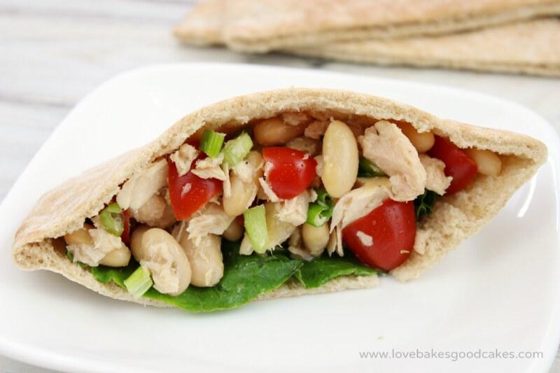 Mediterranean Tuna Salad stuffed into pita bread on a white plate.