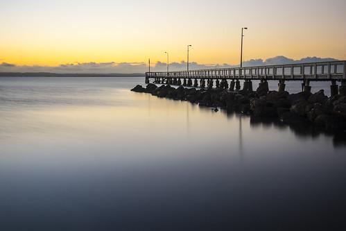 water clouds sunrise pier clear waterreflections sunsetsandsunrisesgold cloudsstormssunsetssunrises