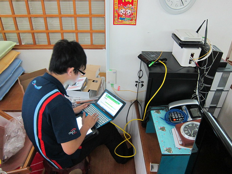 SingTel Technician Setting Up The Internet