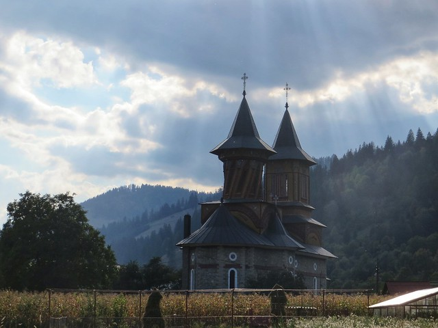 Sun rays on a church in Neamt, Romania