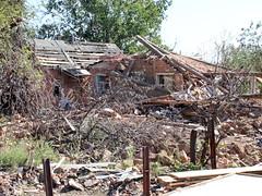 landslide(0.0), hut(1.0), wood(1.0), shack(1.0), ruins(1.0), demolition(1.0),