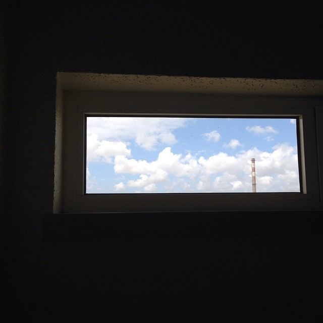 Red factory chimney against blue skye #justframeit #window #windows
