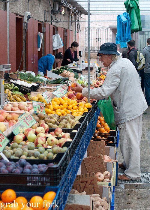 Fruit and vegetable stall at Mercado de Abastos farmers market in Santiago de Compostela, Spain