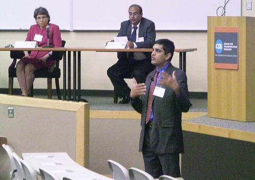 photo of Dr Bhat speaking at symposium
