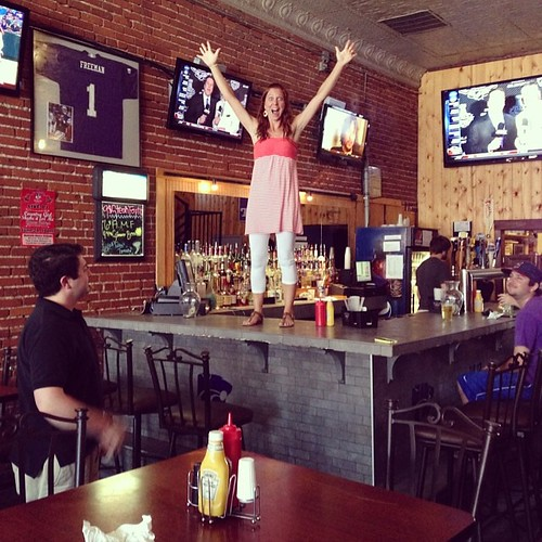 This is Laura on a bar in Aggieville during taste of the ville. Probably worth noting zero alcohol is involved. Thank you @harrietreymond for making this date night happen. #aggieville