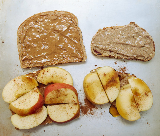 Spread nut butter on all slices, top with apple slices, dash or two of ...