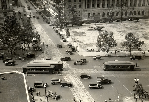 Automobiles and trolleys near Pennsylvania and 14th St. in Washington, D.C., circa 1933.