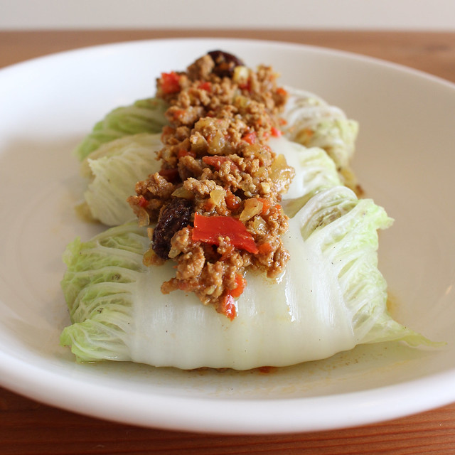 Cuban Picadillo in Napa Cabbage Rolls | via HeartofHomemade.com