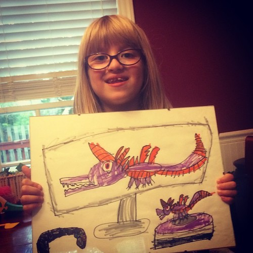 Catie drew Spyro from Skylanders (both on a TV screen & the action figure on the portal). #gamer