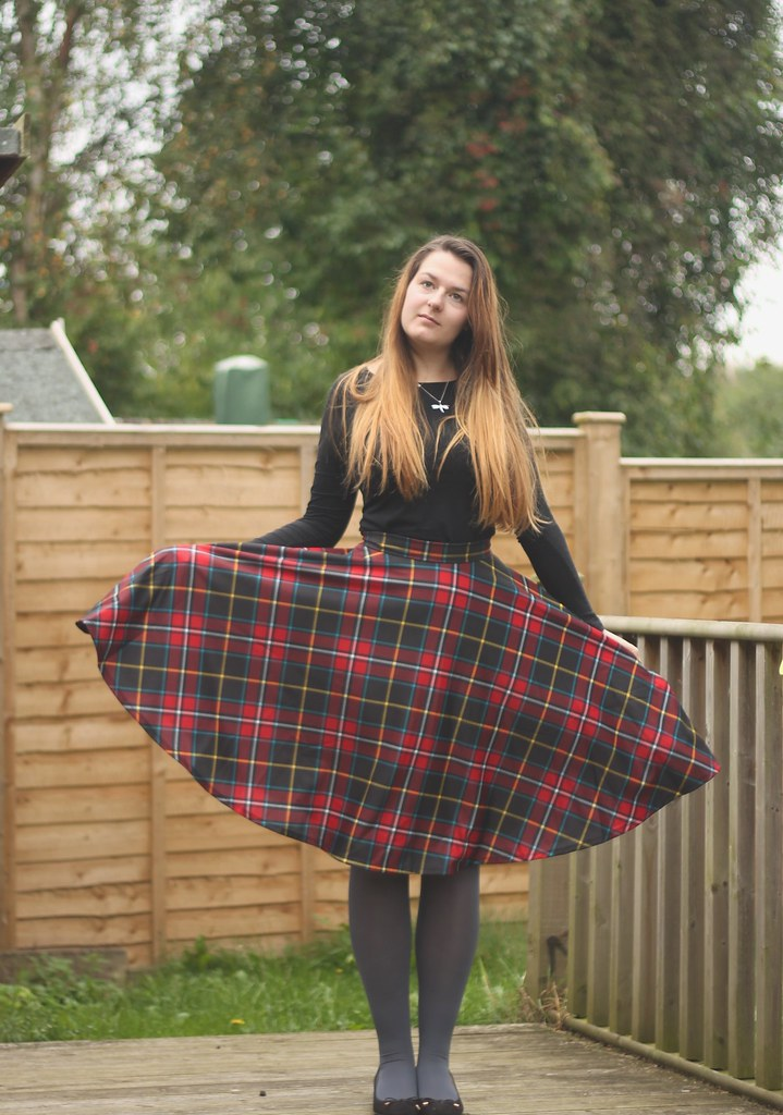 Black top and tartan skirt outfit