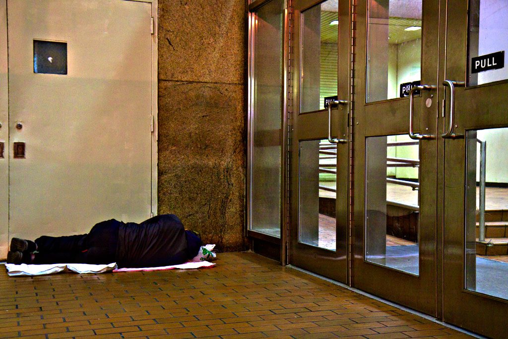 Man-sleeping-just-outside-The-Gallery-on-9-16-14--Center-City