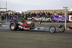 touring car(0.0), indycar series(0.0), formula one(0.0), race car(1.0), auto racing(1.0), automobile(1.0), racing(1.0), sport venue(1.0), vehicle(1.0), sports(1.0), race(1.0), automotive design(1.0), open-wheel car(1.0), motorsport(1.0), drag racing(1.0), race track(1.0),