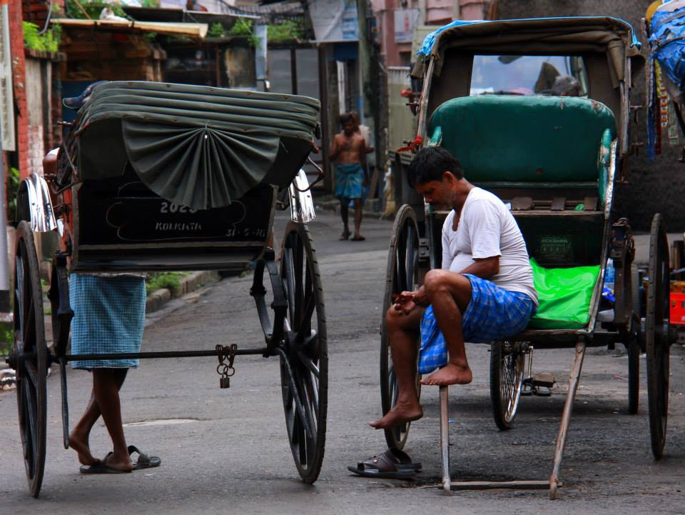 hand pulled rickshaws are one of Kolkata controversies