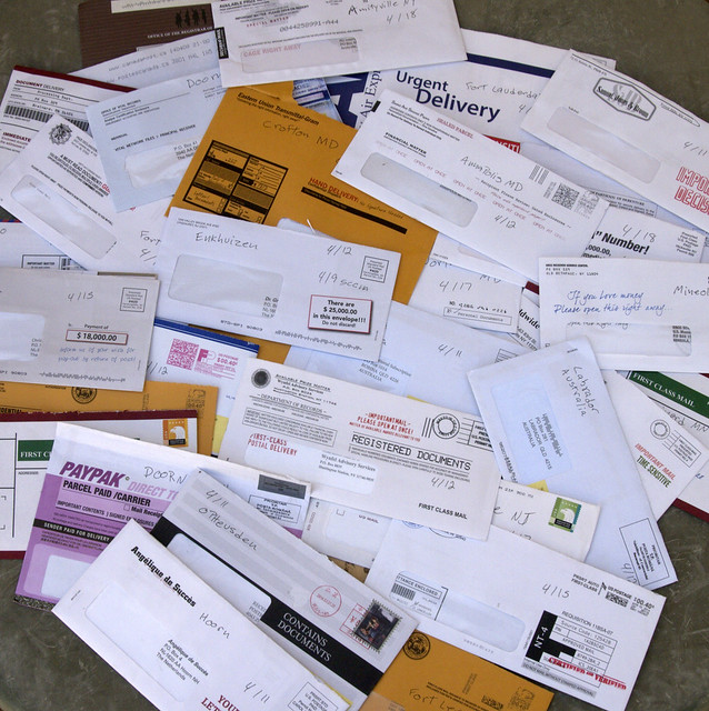 Pile of junk mail scams