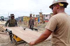 Builder 3rd Class Gabriel Murgaaltan, right, and a member of the Armed Forces of the Philippines work together during a Pacific Partnership engineering project at San Fernando School in Tacloban. (U.S. Navy/MCC Greg Badger)