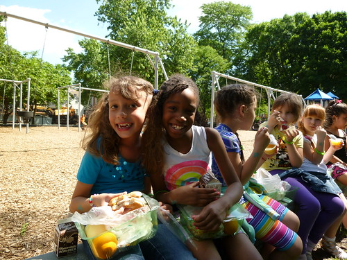 Girls enjoying a healthy meal at a summer meals kick-off event.