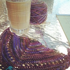 I AM working... Doing a test knit of my sister's @kate_lore shawlette pattern with my hand dyed fingering weight yarn 'Heather Lake'...and a nice iced coffee by my side, on the deck, in the shade on a beautifully warm day.  Really, I am working.