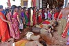 Hindu  devotees rolling towards the entrance of Nallur temple, opening of Nallur Festival, Jaffna