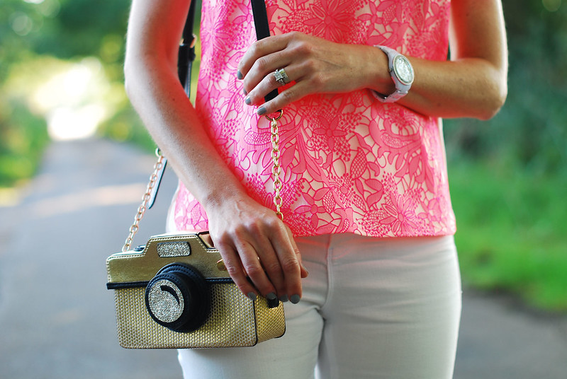Camera bag and neon pink top