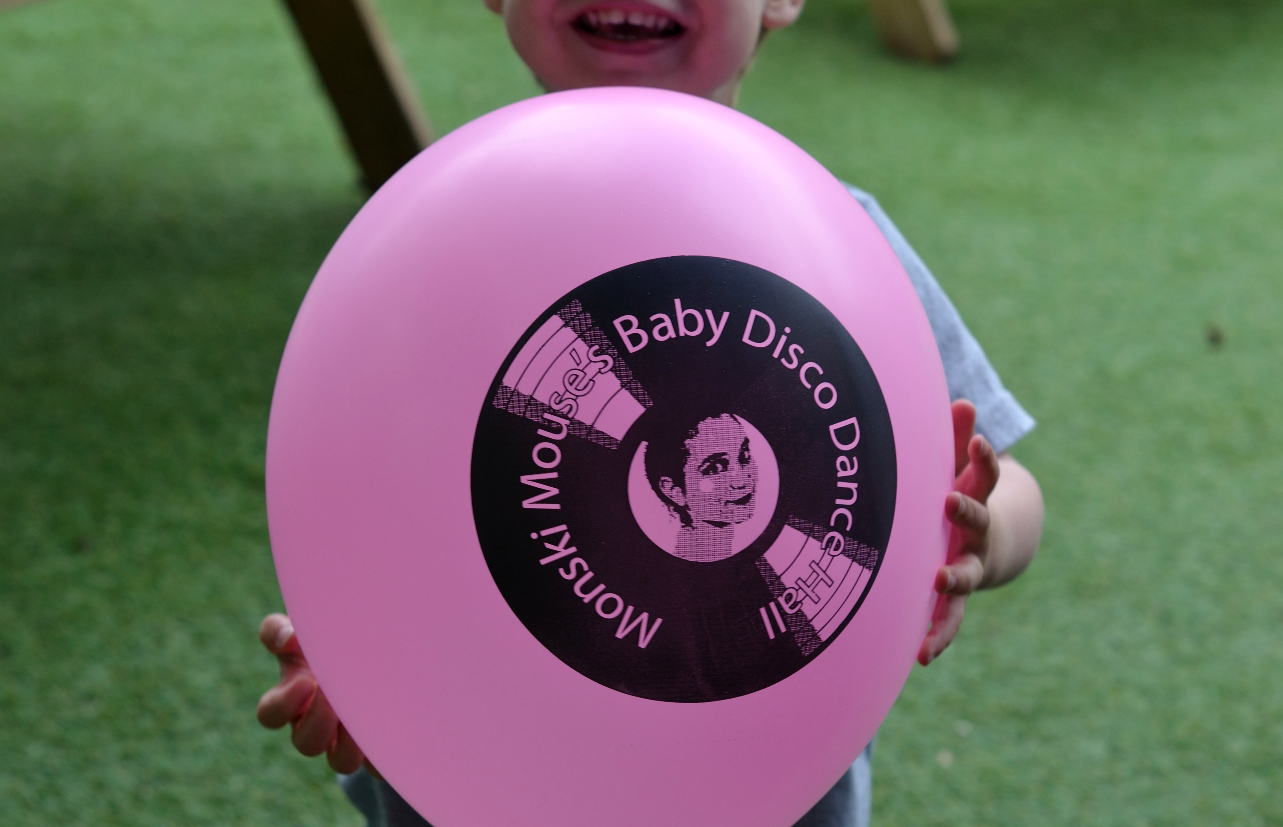 John's pink balloon at Monski Mouse Baby Disco Dance Hall.