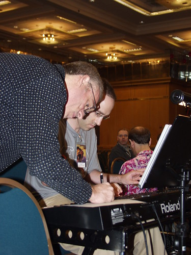 Brad Weage and Joel Abbott go over the musical score before the show.