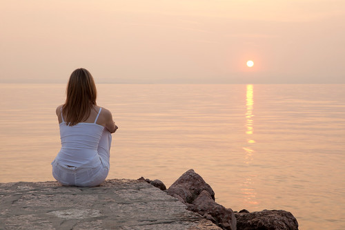 istockphoto image of a woman gazing out to sea