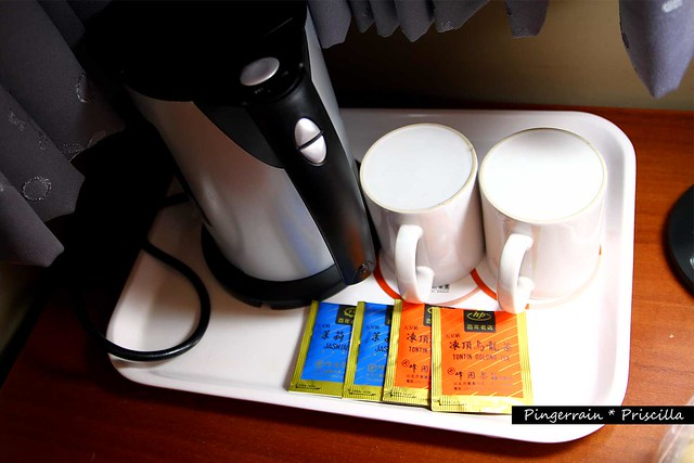 Complimentary 2 bottles of water (not shown) ,  tea, hot water kettle and mugs