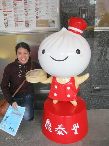 Mei with the Din Tai Fung mascot statue.