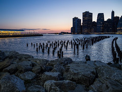 East River, Pier and lower Manhattan at Dusk