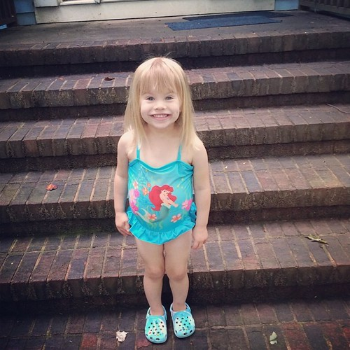 "Lucy's daycare class is having ""water play"" today. She was so excited about wearing her swimsuit to school, she wanted her pic taken too."