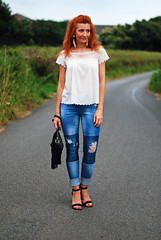 White summer top and distressed patchwork jeans