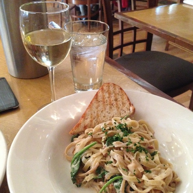 Date night at my favorite homemade pasta place with BriBri. A fettuccine pasta with a garlic wine sauce and scallops. Yumyum. And a glass of Marco Felluga Pinot Grigio. Heaven on a plate!