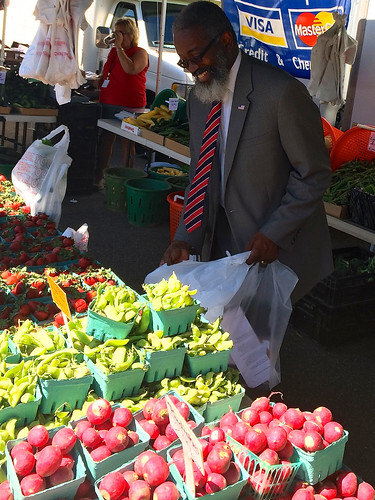 USDA Assistant Secretary, Departmental Management, Dr. Gregory Parham shops for fresh produce at the USDA Farmers Market.  Dr. Parham spoke about USDA's commitment to supporting our active duty military, reservists, veterans and military families at the opening ceremony of the market. USDA photo by Peter Wood.