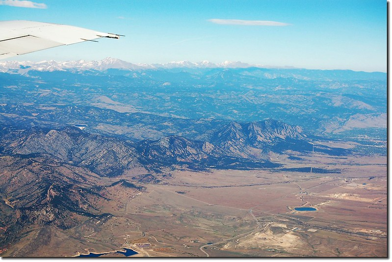 Looking down  Front Range from the air, Longs Peak is the highest summit under the wing 1