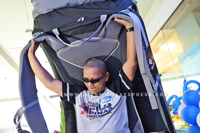 PREMIUM OUTDOOR EQUIPMENT. A giant Deuter backpack being fitted by one of the guest bloggers who attended the opening of its first concept store.