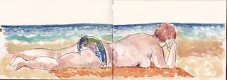 la misma lectora de la playa de Zarautz, se da la vuelta, para seguir leyendo